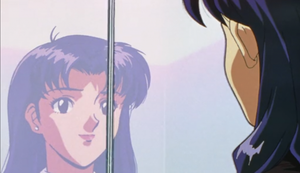 Misato staring at herself in a mirror.