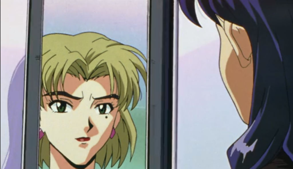Misato and Ritsuko stare at each other through a mirror.